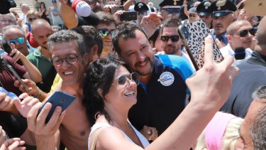Italian Deputy Prime Minister Matteo Salvini poses for selfies with his supporters at Lido Cala Sveva in Termoli.