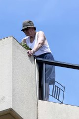Ted Caddick on the balcony of his Edgecliff penthouse.