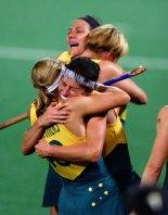 Australian team members embrace after winning the gold medal.