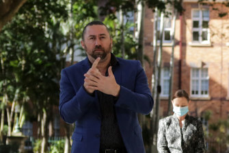 Auslan interpreter Mike Webb has been ordered into 14 days of home quarantine after being identified as a close contact.