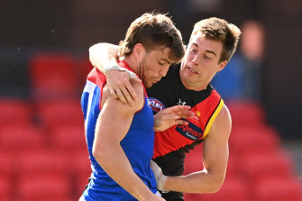 Zach Merrett, right, is returning to the Bombers' leadership group after a hiatus.