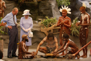 Britain's Queen Elizabeth II and the Duke of Edinburgh watching a culture show at Tjapukai Aboriginal Culture Park, Cairns, 2002.