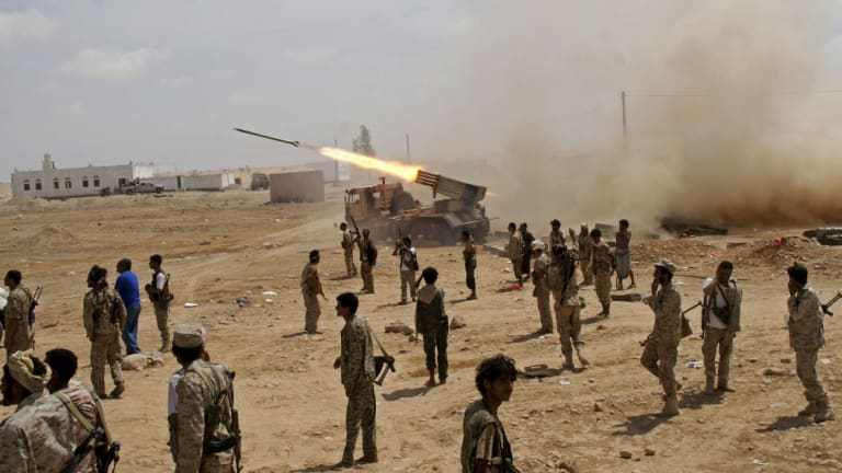 Yemeni soldiers fire rockets at mountainous positions of al-Qaeda militants at the town of Meyfaa, one of many occupied by al-Qaeda, in May 2014.