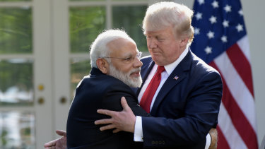 US President Donald Trump and Indian Prime Minister Narendra Modi hug at the White House in 2017.