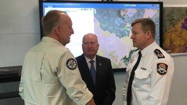 ACT Parks fire manager Neil Cooper, Emergency Services Minister Mick Gentleman, and ESA Commissioner Dominic Lane discuss the bushfire risk.