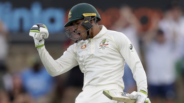 Usman Khawaja celebrates making 100 runs.