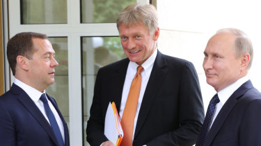 Dmitry Peskov, centre, flanked by Russian Prime Minister Dmitry Medvedev and Russian President Vladimir Putin last May.