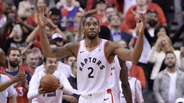 Kawhi Leonard reacts following the Raptors' win in game three against the Bucks.