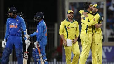 Australia celebrate their win in the third ODI in India.