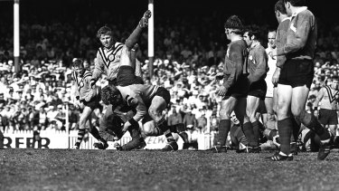 Tiger tough: A Rabbitohs player is taken to ground in a full-blooded tackle during the 1969 grand final.