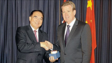 Secretary of the Liaoning province Wang Min with then-premier of NSW Barry O'Farrell at the signing ceremony in 2012.