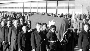 Pallbearers, including Robert Menzies and Billy Hughes, convey the coffin into King's Hall. July 6, 1945