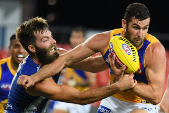 Luke McDonald tackles West Coast's Jack Darling.