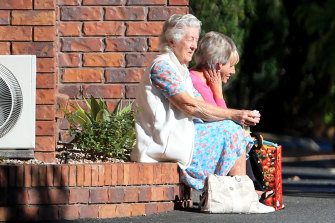 Residents are seen outside the Earle Haven Nursing Home following its shock closure last week.