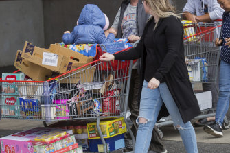 Shoppers stock up on supplies amid  the uncertainty over the coronavirus threat.