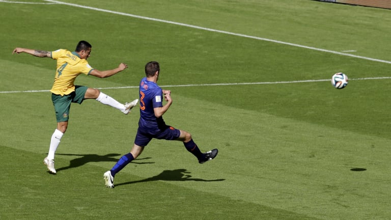 Tim Cahill scores against the Netherlands at the 2014 World Cup in Brazil.