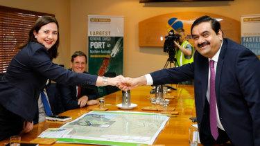 Queensland Premier Annastacia Palaszscuk shaking hands with Adani chairman Gautam Adani in December 2016.