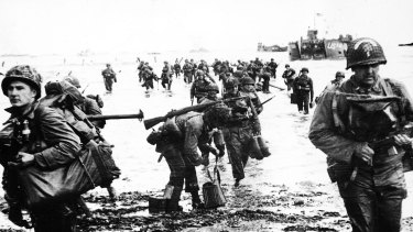 The invasion begins ... US troops come ashore at Normandy.