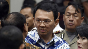 "Former Jakarta governor Basuki ""Ahok"" Tjahaja Purnama talks to his lawyers after his sentencing in May 2017."