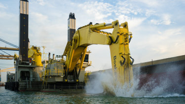 The 72-metre long Magnor dredge is the biggest backhoe in the world.