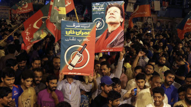 Supporters of Imran Khan celebrate reports of his victory in Islamabad, the capital of Pakistan.