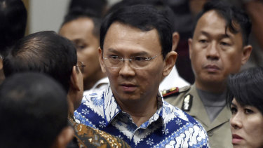 "Former Jakarta governor Basuki ""Ahok"" Tjahaja Purnama,, talks to his lawyers after his sentencing in May last year."