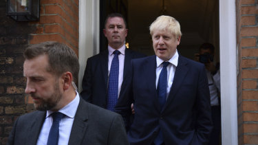 Fit for the job? Boris Johnson, right, leaves his office in London.
