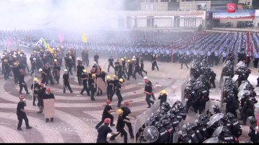 Shenzhen anti-riot police in formation during a simulated protest drill at Waterfront Square on Tuesday.