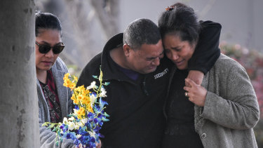 Solomone's parents Salome (right) and 'Atunaisa (centre) visit the scene where their son was killed.