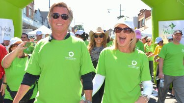 Newton-John with her husband John Easterling at the start of the Wellness walk in 2014.