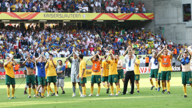 The Socceroos thank their supporters after losing to Italy in the World Cup.