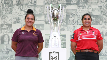 Brisbane captain Amber Hall and Feterika with the NRLW trophy on Friday.