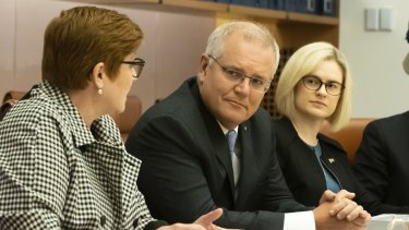 """Minister for Women Marise Payne and PM Scott Morrison with Assistant Minister to the Attorney-General Amanda Stoker (right), who says there is """"more than one way to skin a cat"""" on ending sexual harassment."""
