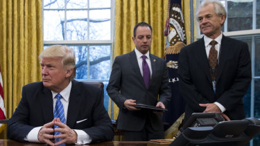 Peter Navarro (far right) in the Oval Office with President Donald Trump and then White House chief of staff Reince Priebus.