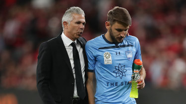Steve Corica and Milos Ninkovic come to terms with defeat in the derby in October.