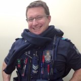 Senior Constable Brett Forte in his police uniform, with a few humorous additions.