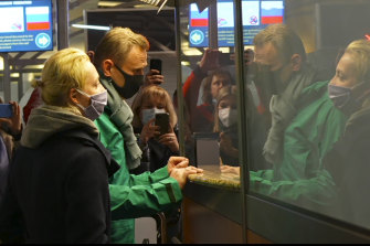 In this grab taken from video, Alexei Navalny and his wife Yulia stand at the passport control before Navalny was detained by police after arriving at Sheremetyevo airport, outside Moscow.