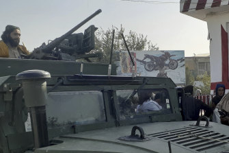 Taliban fighters stand guard in Kunduz city, northern Afghanistan.