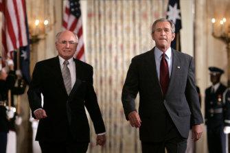 Former US president George W Bush (right) hosted former prime minister John Howard for a state dinner in 2005.
