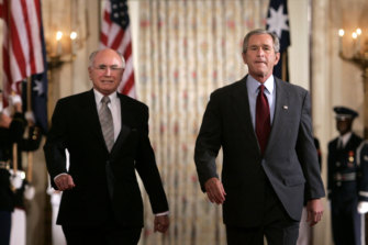 Former US president George W Bush (right) hosted former prime minister John Howard for a state dinner in 2005.