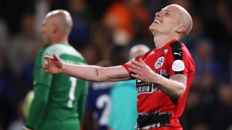 Exhausted: Huddersfield Town managed to avoid the drop, but the battle left its mark on Mooy.