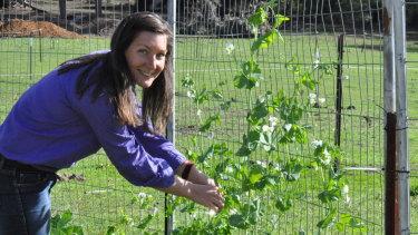 Earth Girl is in her element in the veggie garden.
