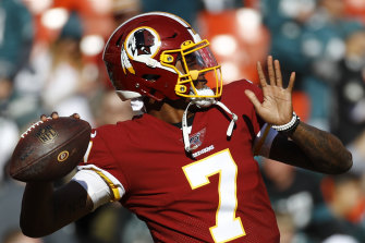 FILE - In this Dec. 15, 2019, file photo, Washington Redskins quarterback Dwayne Haskins warms up before an NFL football game in Landover, Md. A new name must still be selected for the Washington Redskins football team, one of the oldest and most storied teams in the National Football League, and it was unclear how soon that will happen. But for now, arguably the most polarizing name in North American professional sports is gone at a time of reckoning over racial injustice, iconography and racism in the U.S. (AP Photo/Patrick Semansky, File)