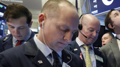 US stocks give up an early rally, ending winning streak