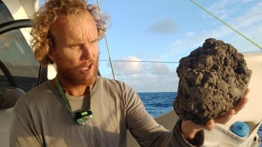 Mick Hoult with a sample of the pumice he encountered sailing to Fiji.