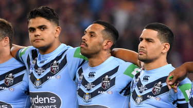 NSW stars Latrell Mitchell, Josh Addo-Carr and Cody Walker during the anthem before Origin I.