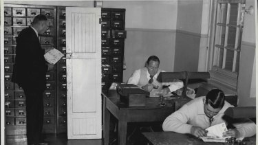 Fingerprint Section of the Criminal Investigation Bureau on July 1, 1954. The  lavatory door on which Ronald Vincent Holl's print was found is shown.