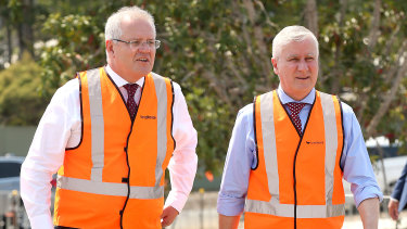 "Deputy Prime Minister Michael McCormack (right), seen with Prime Minister Scott Morrison, said more Coalition seats received grants because ""we hold more regional seats""."