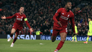 Georginio Wijnaldum celebrates scoring Liverpool's third goal.