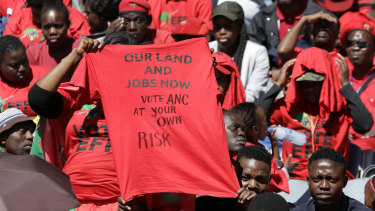 Supporters of the Economic Freedom Fighters (EFF) party attend a rally in Soweto on Sunday.
